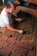 Cuba, March 1992: Man at the color selection in La Corona, The largest cigar factory in Havana.