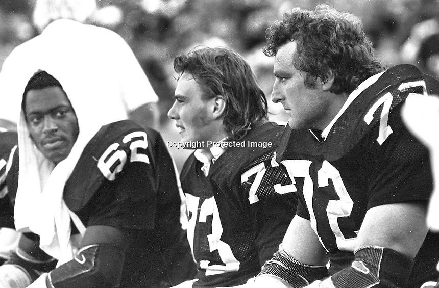 "Raider defensive linemen Reggie Kinlaw, Dave Browning, and the ""Tooz"" John Matuszak. (1980 photo by Ron Riesterer)"