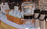 Portola Coffee Lab's table at the South Coast Collection's Farmers' Market.  Featured is a big jug of iced coffee.