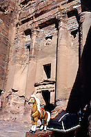 "Jordan. Petra. The archeological site is part of the UNESCO world heritage project.  The Nabataeans were an arabian industrious tribe which settled down in southern Jordan 2000 years ago. Petra is located at the bottom of a spectacular deep gorge surrounded by mountains. ""Urnel Florentius"" tomb. small shop whare are sold various souvenirs to tourists.  © 2002 Didier Ruef"