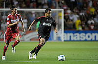 AC Milan midfielder Mancini (30) dribbles away from Chicago Fire defender Krzysztof Krol (23).  AC Milan defeated the Chicago Fire 1-0 at Toyota Park in Bridgeview, IL on May 30, 2010.