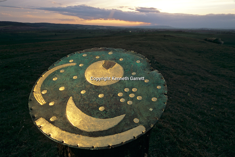 Sky disk oriented to track the summer and winter solstices using distant landmarks, depicts night sky, possible agricultural calendar, buried on Mittelberg Hill, near Nebra, Sky Disk; Bronze Age; Ancient Cultures; Germany