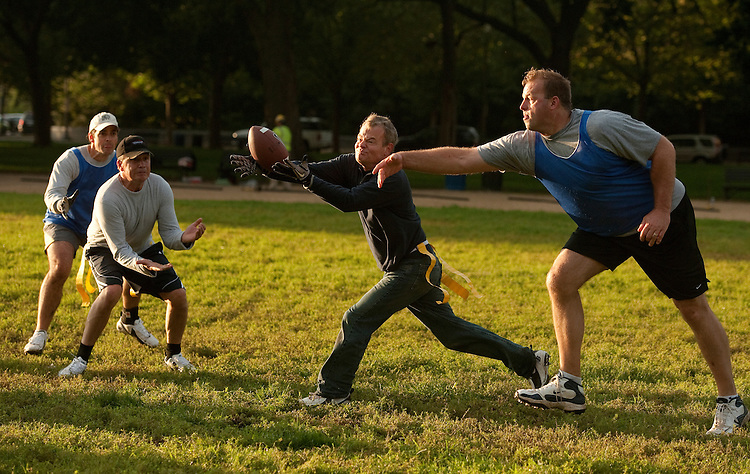 UNITED STATES - OCTOBER 04:  Rep. Mike McIntyre, D-N.C., catches a pass over defender Rep. Jon Runyan, R-N.J., during a congressional football practice on the Mall in preparation for the upcoming game between members of Congress and the Capitol Police.  (Photo By Tom Williams/Roll Call)