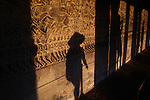 Shadows on the wall of the west gallery at Angkor Wat, Cambodia. June 8, 2013.