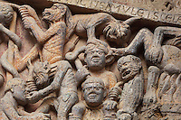 Hell, with men being tortured and killed by demons, early 12th century Romanesque, carved by the Master of the Tympanum, from the tympanum of the Last Judgement above the portal on the West facade of the Abbatiale Sainte-Foy de Conques or Abbey-church of Saint-Foy, Conques, Aveyron, Midi-Pyrenees, France, a Romanesque abbey church begun 1050 under abbot Odolric to house the remains of St Foy, a 4th century female martyr. The church is on the pilgrimage route to Santiago da Compostela, and is listed as a historic monument and a UNESCO World Heritage Site. Picture by Manuel Cohen