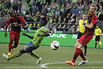 Seattle Sounders Obafemi Matrins (9) heads the ball away from  Portland Timbers Nat Borchers (7) during an MLS match on April 26, 2015 at CenturyLink Field in Seattle, Washington.  Seattle Sounders Clint Dempsey scored a goal to give the Sounders a 1-0 victory over the Timbers. Jim Bryant Photo. ©2015. All Rights Reserved.
