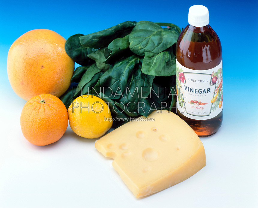 ACIDS IN FOOD<br /> Many Foods Contain Acid<br /> Grapefruit, orange and lemon contain citric acid, spinach contains oxalic acid, vinegar has acetic acid and swiss cheese has lactic acid.