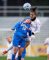 Chelsea Stewart (19) of UCLA goes up for a header with M. Bakowska-Mathews (21) of Florida State during the NCAA Women's College Cup finals at WakeMed Soccer Park in Cary, NC.  UCLA defeated Florida State, 1-0, in overtime.