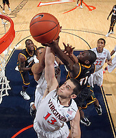 CHARLOTTESVILLE, VA- DECEMBER 6: Sammy Zeglinski #13 of the Virginia Cavaliers reaches for the rebound in front of Vertrail Vaughns #11 of the George Mason Patriots during the game on December 6, 2011 at the John Paul Jones Arena in Charlottesville, Virginia. Virginia defeated George Mason 68-48. (Photo by Andrew Shurtleff/Getty Images) *** Local Caption *** Sammy Zeglinski;Vertrail Vaughns