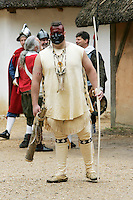 Costume character at replica colonial fort heritage tourist attraction at Jamestown, Williamsburg, Virginia, United States of America
