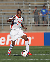Cuban midfielder Alberto Gomez (20) dribbles. In CONCACAF Gold Cup Group Stage, the national team of Cuba (white) defeated national team of Belize (red), 4-0, at Rentschler Field, East Hartford, CT on July 16, 2013.