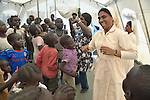 Sister Amala Francis, a member of the Daughters of Mary Immaculate, leads a group of children in dancing inside a camp for internally displaced families inside a United Nations base in Juba, South Sudan. The camp holds more than 20,000 Nuer who took refuge there in December 2013 after a political dispute within the country's ruling party quickly fractured the young nation along ethnic and tribal lines. Ten DMI sisters from India work in the camp, providing counseling and psycho-social support for women and children, teaching children in makeshift schools, and providing food to hungry families.
