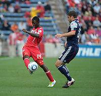 Chicago forward Patrick Nyarko (14) shoots the ball while being defended by New England defender Chris Tierney (8).  The Chicago Fire defeated the New England Revolution 3-2 at Toyota Park in Bridgeview, IL on Sept. 25, 2011.