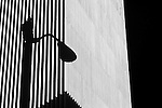 Silhouetted lamp post in front of building on a sunny afternoon downtown Seattle Washington State USA