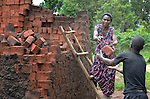 Prossy Nalazibwe makes bricks in Kabulasoke, Uganda, where the Ntulume Village Women Development Association has trained women in improved agricultural practices, thus increasing food security and empowering women and children. Nalazibwe has been an enthusiastic participant in the program, which was supported by funding from the Call to Prayer and Self-Denial of United Methodist Women.