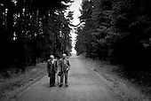 Cernovice, Czech Republic.July 1997.These two men live in an old folks home deep in rural Czech Republic. Everyday they escape and walk one kilometer to enjoy a cigarette or two, which is forbidden in the home..