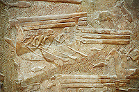 Stone relief sculptured panel of cedar of Lebanon being transported. From the northern courtyard,  Inv AO 19890 from Dur Sharrukin the palace of Assyrian king Sargon II at Khorsabad, 713-706 BC.  Louvre Museum Room 4 , Paris