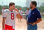 San Francisco 49ers training camp August 4, 1988 at Sierra College, Rocklin, California.  San Francisco 49ers quarterback Steve Young (8) talks to former Chargers quarterback Dan Fouts.