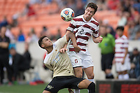 Houston, TX -  Sunday, December 11, 2016: Logan Gdula (17) of the Wake Forest Demon Deacons battles for the ball with Foster Langsdorf (2) of the Stanford Cardinal at the  NCAA Men's Soccer Finals at BBVA Compass Stadium.