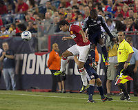 Manchester United FC defender Fabio Da Silva (20) and New England Revolution midfielder Sainey Nyassi (17) battle for head ball. In a Herbalife World Football Challenge 2011 friendly match, Manchester United FC defeated the New England Revolution, 4-1, at Gillette Stadium on July 13, 2011.