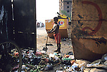 Rubbish collectors sift through the public waste in Dhaka.. the capital of Bangladesh.