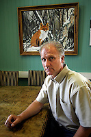 Govenor of the prison &Oslash;yvind Aln&aelig;s in front of a painting made by an inmate...Bast&oslash;y Prison/Horten/Norway. &copy;Fredrik Naumann/Felix Features