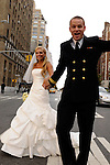 Blond bride and groom in Navy uniform dancing down Park Avenue in NYC following their ceremony.
