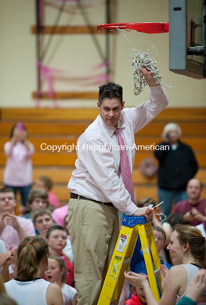 THOMASTON, CT 15 FEBRUARY 2013-021513JS07--Thomaston Head Coach Bob McMahon finishes cutting down the net following their 55-48 win over Nonnewaug to capture the Berkshire League title Friday at Thomaston High School..Jim Shannon Republican-American