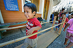 Three-year old son Eduardo de Jesus Ruiz walks between parallel bars during a session of the early intervention program of Piña Palmera, a center for community based rehabilitation for people living with disabilities in Zipolite, a town in Oaxaca, Mexico. The boy lives with some developmental disability.