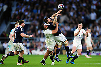 Cornell Du Preez of Scotland offloads the ball after being tackled by Billy Vunipola of England. RBS Six Nations match between England and Scotland on March 11, 2017 at Twickenham Stadium in London, England. Photo by: Patrick Khachfe / Onside Images
