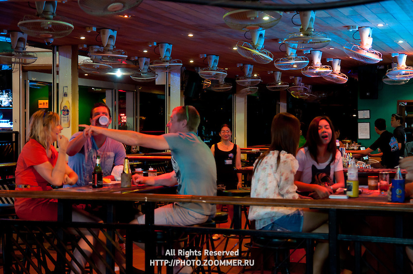 Tourists and Thai girls in night bar on Bangla Road in Phuket, Thailand