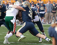 Pitt linebacker Mike Caprara makes a tackle. The Miami Hurricanes football team defeated the Pitt Panthers 29-24 on  Friday, November 27, 2015 at Heinz Field, Pittsburgh, Pennsylvania.