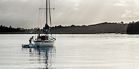 Vintage yacht, Petrel, at anchor in Waikorariki Bay, Waiheke Island.  This yacht was involved in the Dunkirk evacuation.  Ponui Island behind.