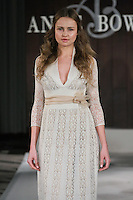 Model walks runway in a Peace wedding dress by Anne Bowen, for the Anne Bowen Bridal Spring 2012 runway show.
