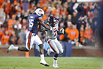 Ole Miss' Tobias Singleton (7) is chased by Auburn defensive back Neiko Thorpe (15) at Jordan-Hare Stadium in Auburn, Ala. on Saturday, October 29, 2011. .
