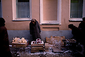 Moscow, Russia<br /> Soviet Union<br /> December 11, 1991<br /> <br /> An elderly woman sells goods along a street side in central Moscow in the early morning. A very common scene in Moscow just after the break up of the former Soviet Union. <br /> <br /> In December 1991, food shortages in central Russia had prompted food rationing in the Moscow area for the first time since World War II. Amid steady collapse, Soviet President Gorbachev and his government continued to oppose rapid market reforms like Yavlinsky's &quot;500 Days&quot; program. To break Gorbachev's opposition, Yeltsin decided to disband the USSR in accordance with the Treaty of the Union of 1922 and thereby remove Gorbachev and the Soviet government from power. The step was also enthusiastically supported by the governments of Ukraine and Belarus, which were parties of the Treaty of 1922 along with Russia.<br /> <br /> On December 21, 1991, representatives of all member republics except Georgia signed the Alma-Ata Protocol, in which they confirmed the dissolution of the Union. That same day, all former-Soviet republics agreed to join the CIS, with the exception of the three Baltic States.