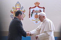 King Abdullah II of Jordan, greets Pope Benedict XVI, on pope's arrival in Amman, Jordan Friday, May 8, 2009..