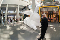 """Seven giant inflatable rabbit sculptures, entitled """"Intrude"""" by the Australian artist Amanda Parer go on display in Brookfield Place in Lower Manhattan in New York on Sunday, April 17, 2016. Organized by Arts Brookfield the nylon monumental sculpture displays the humor of over-sized bunnies revealing the more serious side of an environmental problem as rabbits are an invasive species in Australia. The exhibit will be on view until April 30 when it goes on tour to Houston and Los Angeles. (© Richard B. Levine)"""