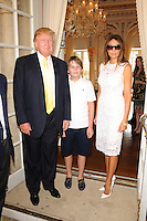 PALM BEACH FL - JANUARY 4:  Donald Trump, Barron Trump and Melania Trump attend The Trump Invitational Grand Prix at Club Mar-a-Lago on January 4, 2015 in Miami, FL Florida. Credit: mpi04/MediaPunch
