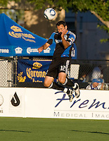 Ramiro Corrales of Earthquakes hits the ball with his head during the game against the WhiteCaps at Buck Shaw Stadium in Santa Clara, California on July 20th, 2011.  Earthquakes and WhiteCaps are tied 1-1 at halftime.
