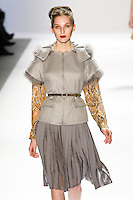Kelsey Van Mook walks the runway in a Luca Luca Fall 2011 outfit, designed by Raul Melgoza, during Mercedez-Benz Fashion Week, February 10, 2011