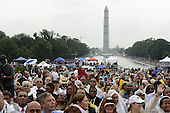 A crowd gathers to hear US President Barack Obama (not pictured) deliver remarks during the 'Let Freedom Ring' commemoration event, at the Lincoln Memorial in Washington DC, USA, 28 August 2013. The event was held to commemorate the 50th anniversary of the 28 August 1963 March on Washington led by the late Dr. Martin Luther King Jr., where he famously gave his 'I Have a Dream' speech.<br /> Credit: Michael Reynolds / Pool via CNP