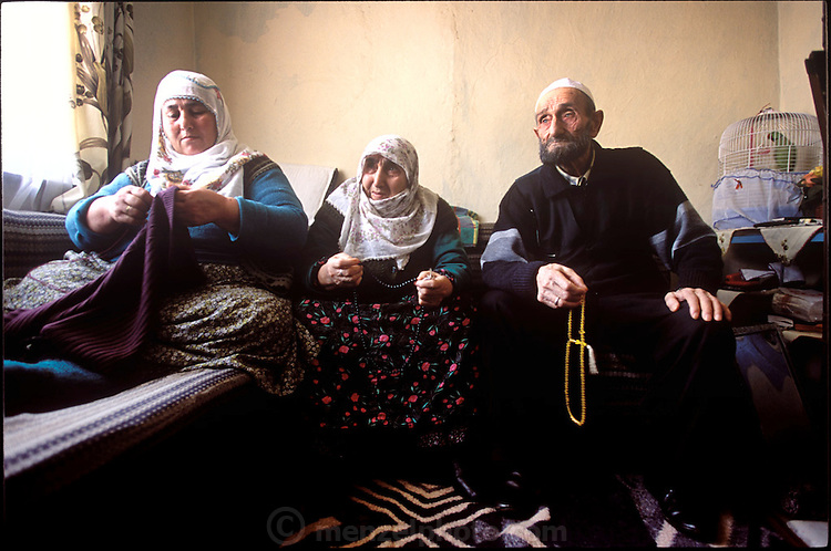 (MODEL RELEASED IMAGE). In the Golden Horn area of Istanbul, Turkey, the Çinar family gathers in their living room. Left to right: Safiye Çinar, her mother Emine, and father Mehemet. (Supporting image from the project Hungry Planet: What the World Eats.)