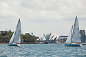 Sailing on the harbor with views of Sydney, Opera House and Sydney Bridge.  Sydney, Australia