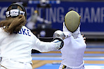 DURHAM, NC - FEBRUARY 25: Notre Dame's Amanda Sirico (right) attacks Duke's Rita Somogyi (left) in the Women's Epee championship match. The Atlantic Coast Conference Fencing Championships were held on February, 25, 2017, at Cameron Indoor Stadium in Durham, NC.
