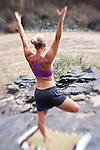 Kate Harvey practices yoga during a river trip down the Colorado River in Westwater Canyon, Utah.
