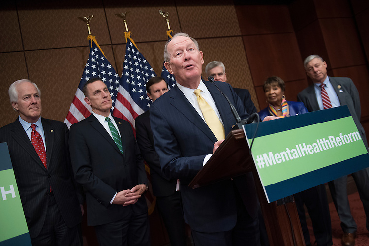 UNITED STATES - DECEMBER 05: Sen. Lamar Alexander, R-Tenn., speaks during a news conference in the Capitol Visitor Center to call on the Senate to pass mental health reform legislation, December 05, 2016. Also appearing are, from left, Senate Majority Whip John Cornyn, R-Texas, Rep. Tim Murphy, R-Pa., Sens. Chris Murphy, D-Conn., Bill Cassidy, R-La., Rep. Eddie Bernice Johnson, D-Texas, and Rep. Fred Upton, R-Mich. (Photo By Tom Williams/CQ Roll Call)
