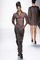 Model walks runway a DESERT SILK GAZA LINEN FITTED SHIRT + HIP-HUGGING A-LINE MAXI JEAN SKIRT. by Zang Toi, for the Zang Toi Spring 2012 My Dream Of North Africa Collection, during Mercedes-Benz Fashion Week Spring 2012.