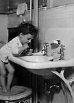Wilkinsburg PA:  Helen Stewart brushing her teeth before bed - 1918