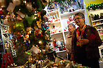 Betty Ching and Nancy Williams of Los Altos examine trees of holiday decorations at Cranberry Scoop.